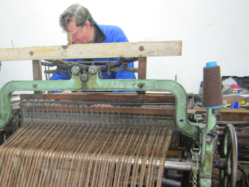 Iain Macleod working at a Hattersley loom